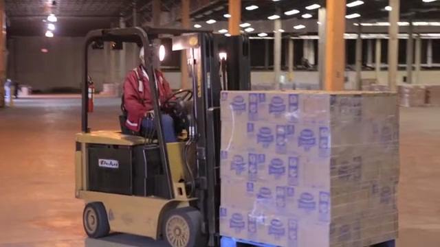 American Red Cross volunteers unloading pallets of Nestlé Pure Life® bottled water at a warehouse in Somerset New Jersey. The water was being distributed this weekend to shelters and communities in New Jersey where people impacted by Hurricane Sandy needed access to drinking water.