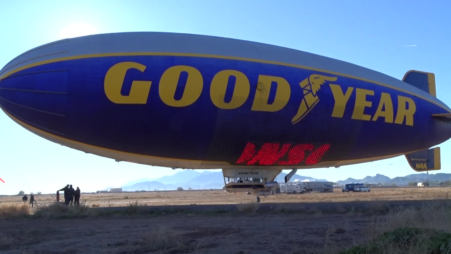 "The Goodyear Blimp ""Spirit of Innovation"" uses its Eagle Vision sign to announce that The Goodyear Tire & Rubber Company has renewed its title sponsorship of the Cotton Bowl with a multiyear deal."