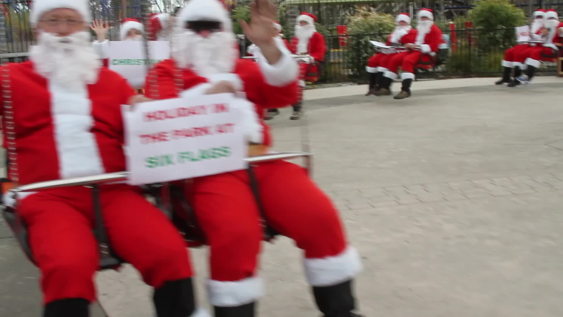 Thirty-two jolly Santas took over the SkyScreamer tower ride at Six Flags Discovery Kingdom as part of a Six Flags Flying Santas Day in conjunction with its sister parks in Arlington and San Antonio. Lively and animated Santas of all shapes and sizes prodded their invisible Comets, Prancer, Donners and Blitzens to the top of the 150' tower swing ride in celebration of the holidays and the park's annual Holiday in the Park celebration.