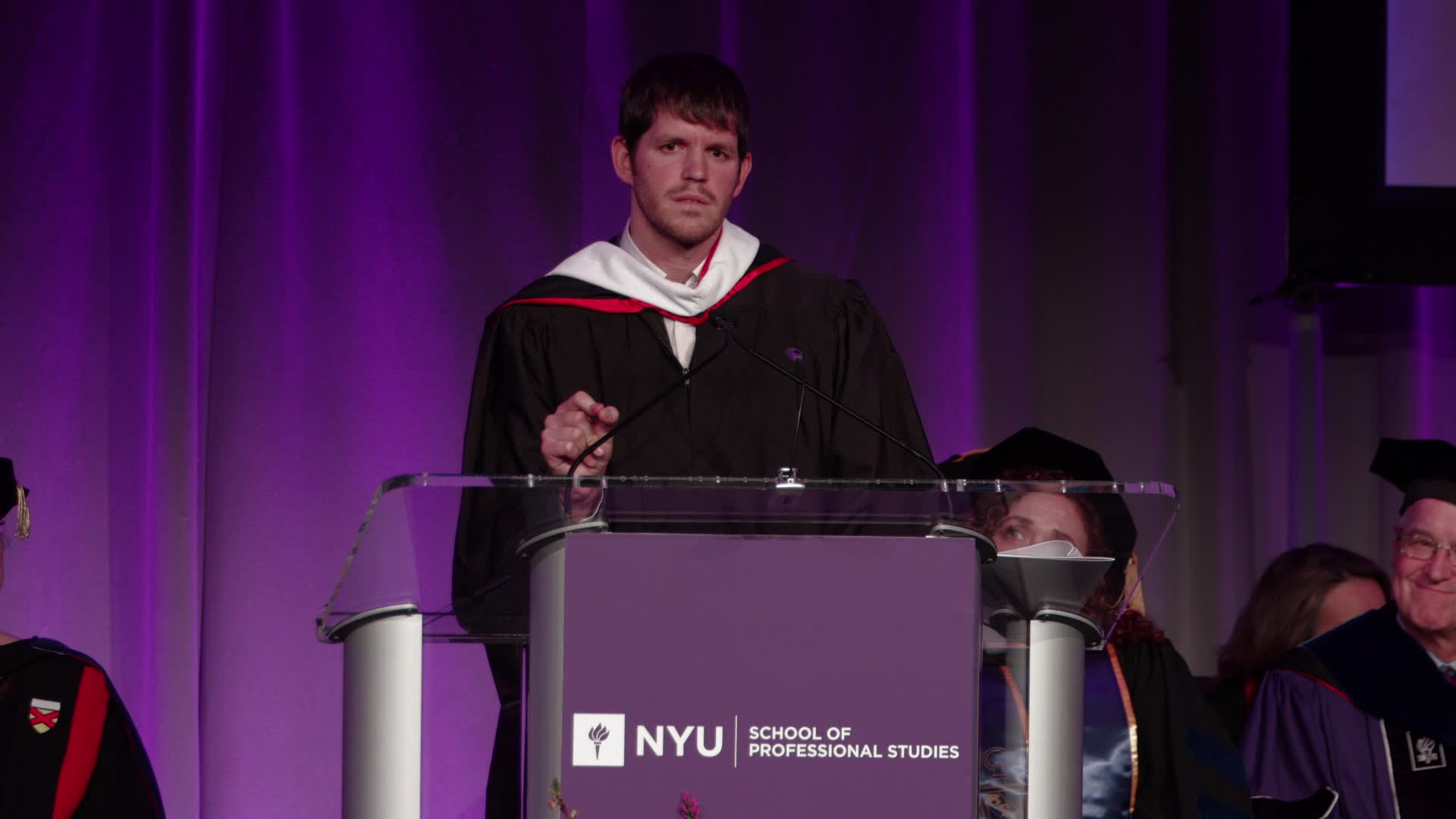 Acclaimed Photographer & Founder of Humans Of NY Brandon Stanton delivered a stirring speech to graduates of the NYU School of Professional Studies, who received their degrees at the Undergraduate Convocation ceremony on May 15 at the Grand Hyatt New York. He reminded students that time is the most valuable resource in the world and it should not be squandered. Instead, he urged them not to wait for their idea or plan to be perfect, but to take the step now to pursue their dreams. Credit: NYUSPS